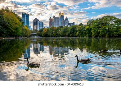 Skyline and reflections of midtown Atlanta, in Lake from Piedmont Park, Early Evening sunset, with Geese
