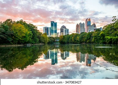 Skyline and reflections of midtown Atlanta, in Lake from Piedmont Park, Early Evening sunset