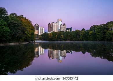 Skyline and reflections of midtown Atlanta, in Lake from Piedmont Park, early morning just before sunrise