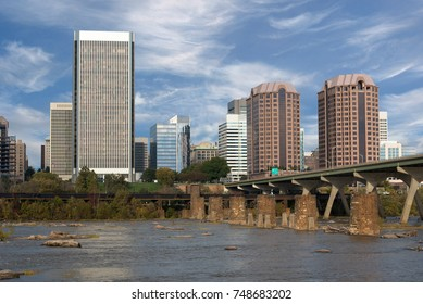 Skyline of Richmond, Virginia. The Manchester Bridge is shown at right. If you look closely you can see kayakers paddling on the James River.