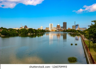 Skyline of Rochester, New York along Genesee River at sunset.