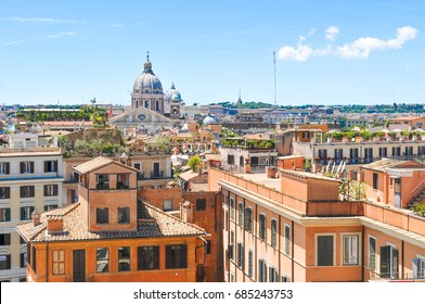 Skyline of Rome over the rooftops of old buildings