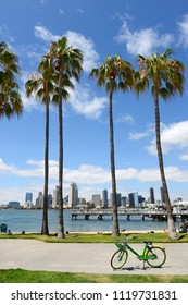 Skyline of San Diego, California with blue skies and palm trees