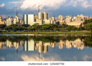 Skyline of Sao Paulo city and reflex in lake