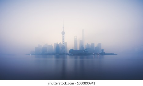 Skyline of Shanghai in China during a polluted and foggy morning , smog ,