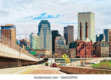 Skyline of skyscrapers and Boston road with car traffic, MA, USA.