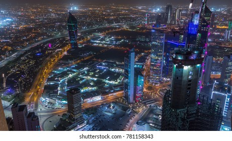 Skyline with Skyscrapers night timelapse in Kuwait City downtown illuminated at dusk. Kuwait City, Middle East. View from rooftop with foggy weather