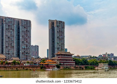 Skyline of Small Chinese City on River. Contrast Between Historic Traditional Buildings and Modern Towers. Juxtaposition between Old and New.(Leshan, Sichuan Province, China).