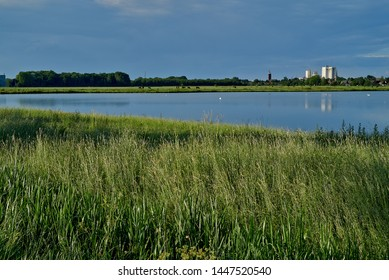 skyline of the small city Brake (Unterweser), district Wesermarsch (Germany) reflecting in the water of the biotope called Kleipütte