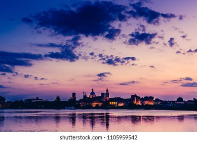 skyline at sunset and pier on the lake - italian landcsape and travel destinations - Mantua italy