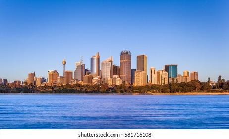 The skyline of the Sydney central business district at sunrise, Sydney, Australia.