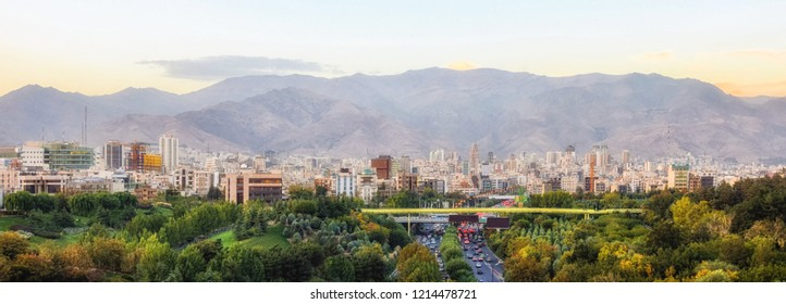 Skyline of Tehran, Iran with high rise buildings against mountains.