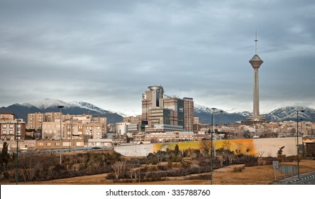 Skyline of Tehran with residential and commercial buildings, Milad Tower and Alborz Mountains.