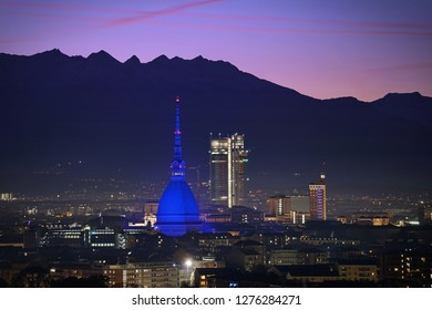 Skyline of Turin, Italy. Night view of city center and the Mole Antonelliana illuminated for Christmas.
