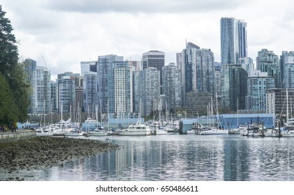 The Skyline of Vancouver - amazing view from Stanley Park - VANCOUVER / CANADA - APRIL 12, 2017