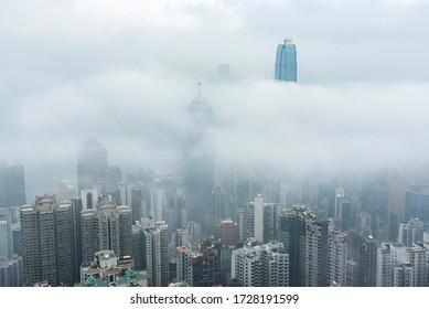 Skyline of Victoria harbor of Hong Kong city in fog
