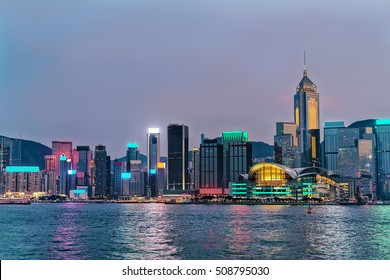Skyline and Victoria Harbor, of Hong Kong. View from Kowloon on HK Island. In the evening