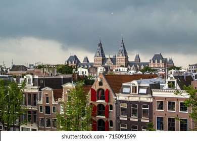 A skyline view of the historic center of the city of Amsterdam.