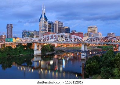 Skyline view of John Seigenthaler Pedestrian Bridge over the Cumberland River and downtown Nashville, Tennessee at daybreak.