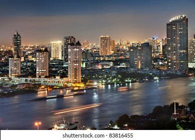 Skyline view of modern buildings at Chaophaya river, Bangkok city of Thailand.At twilight many tourist  paid for dinner on the ship transport for sight seeing Bangkok in night time