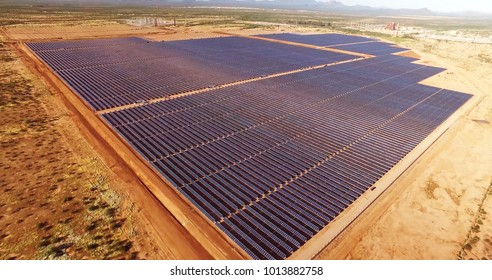 skyline view of solar power panels, in desert.