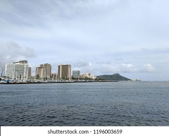 Skyline of Waikiki and Diamond Head during day with yachts and boats in Ala Moana harbor, Hotels, Crane, and Hilton Hawaiian Village framing Diamond Head in Waikiki, Oahu, Hawaii.  2018