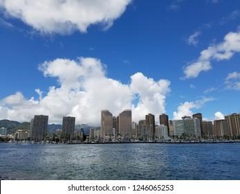 Skyline of Waikiki and Diamond Head during day with yachts and boats in Ala Moana harbor, Hotels, Crane, and Hilton Hawaiian Village framing Diamond Head in Waikiki, Oahu, Hawaii.  2017