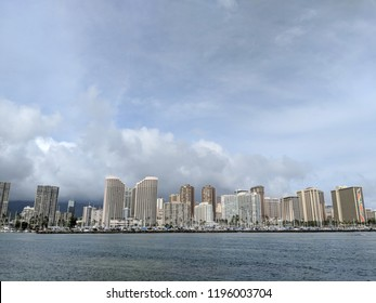 Skyline of Waikiki during day with yachts and boats in Ala Moana harbor, Hotels, Crane, and Hilton Hawaiian in Waikiki, Oahu, Hawaii.  2018
