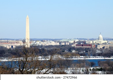 Skyline of Washington DC in winter, including the Washington Monument, the National Mall and the Capitol, as seen from Arlington, Virginia, across the Potomac River.