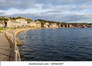 Skyline and waterfront promenade in Oban, Argyll, Scotland, in a warm, bright and sunny summer sunset. This harbour is the gateway to Mull and the islands, and the fishermen base for seafood captures.