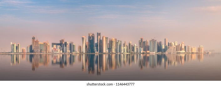 The skyline of West Bay and stony bank view from Museum of islamic art during sunset Doha, Qatar