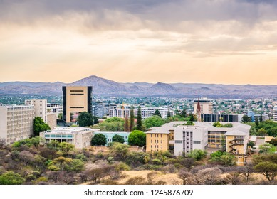Skyline of Windhoek, capital city of Namibia, tourist destination in Southern Africa, golden sky at sunset