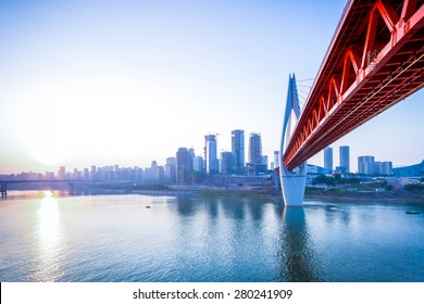 skyline,river and bridge during sunset