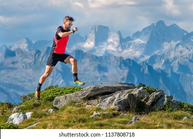 A skyrunner athlete man trains in the high mountains.