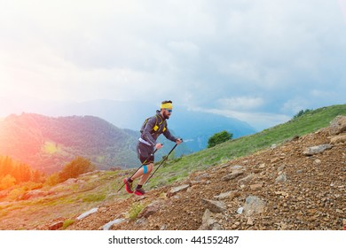 Skyrunner athlete while training for mountain trail with sticks