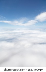 Skyscape, aerial view above Earth covered with a blanket of cloud and blue sky above. Ideal for an environment template or background.