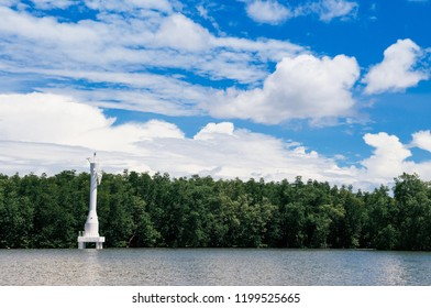 Skyscape blue summer sky with clouds and tropical mangrove forest and white Lighthouse marine traffic signal in Trat, Thailand