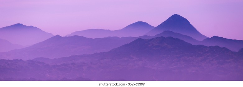Skyscape of cold purple mountains with mist and fog close to Quetzaltenango in Guatemala