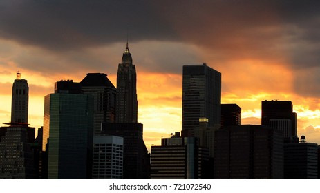 Skyscraper cityscape view of many silhouette modern buildings with twilight sky at dusk  during sunset in New York city, USA.