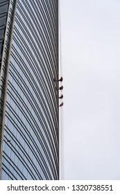 Skyscraper cleaning process.