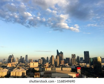 The skyscraper in downtown Bangkok, the capital of Thailand in southeast Asia, with white cloud and blue sky at sunshine morning in horizontal view.