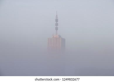 Skyscraper in the fog