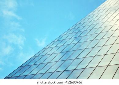 Skyscraper with glass facade. Modern building.