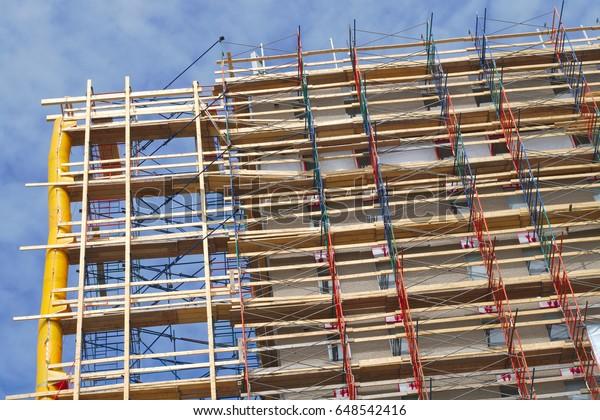 skyscraper ladder scaffold building construction site renovation high facade