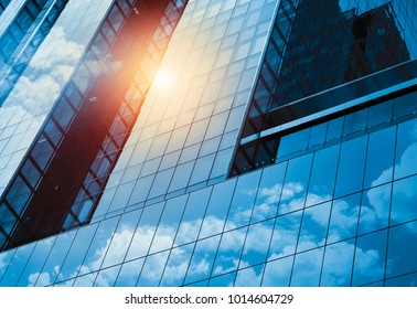 Skyscraper or modern building in the city with cloud and sunlight