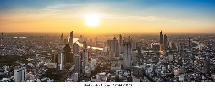 Skyscraper on cityscape at Chaopraya river in Bangkok metropolis Thailand on sunset time