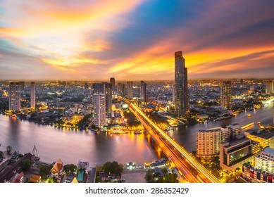 Skyscraper on night scene cityscape at Chaopraya river in Bangkok metropolis Thailand