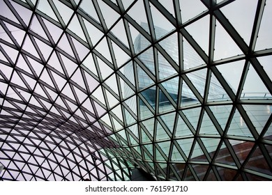 Skyscraper through the glass roof of mall. Close up photo