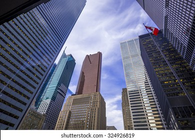 Skyscrapers against a cloudy blue sky in financial district of Toronto  Canada.