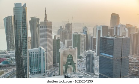 Skyscrapers before sunset timelapse in the skyline of commercial center of Doha, the capital Qatar. Aerial top view at foggy weather. Traffic on the road